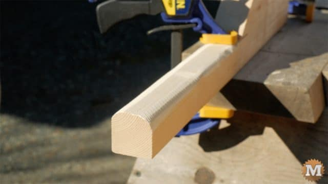 firewood cutting jig - clamped rounded handles