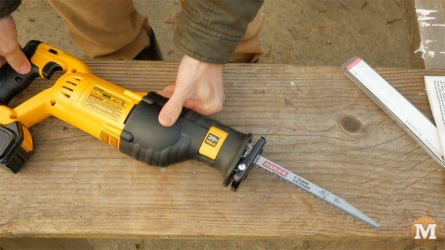 Pruning reciprocating saw with blade