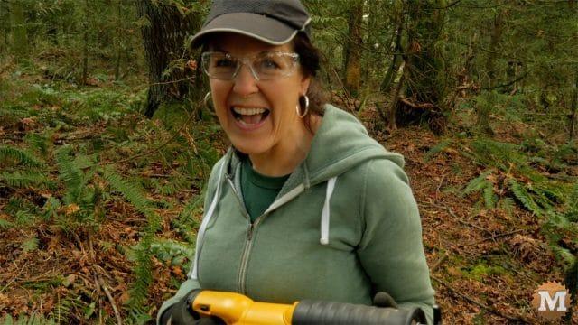 Pruning reciprocating saw lauging woman