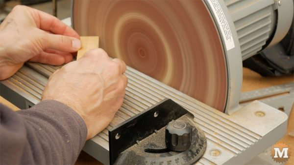 DIY One-Handed Cutting Board - chamfer edges and corners on disc sander