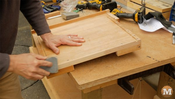 DIY One-Handed Cutting Board - finish up with sanding block
