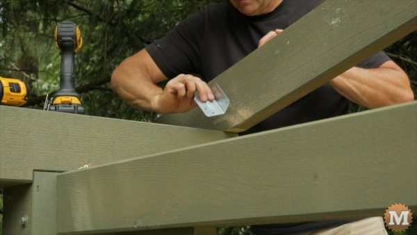 End rafters are secured with a small galvanized angle bracket