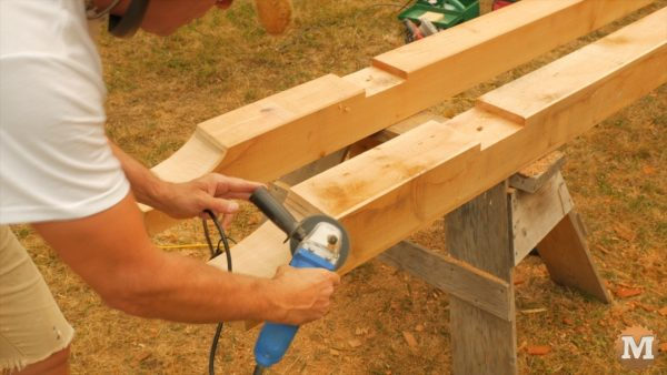 Angle grinder with sanding disc is very good for quickly chamfering in tight spots - Timber Frame Gazebo