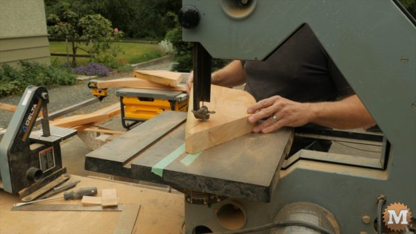 The curves of the brace are rough cut on a bandsaw