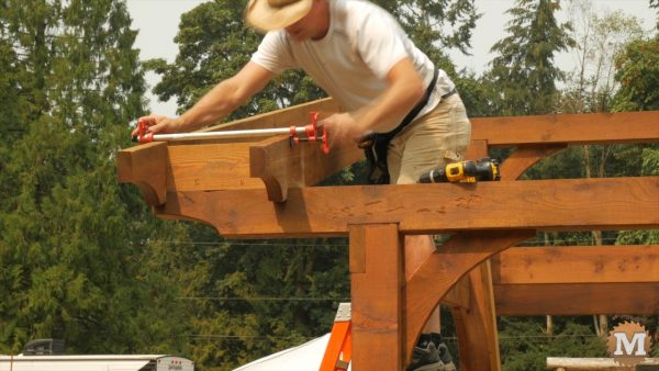 I secure each rafter to the beam and the support blocks between rafters. I straighten them with small pipe clamps