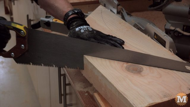 handsaw finishes the cut