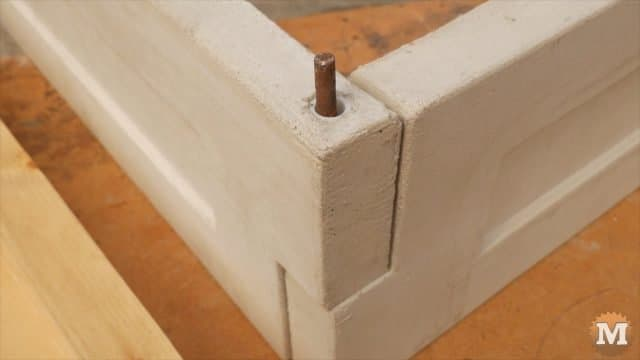 Pinned at the corners with metal bar