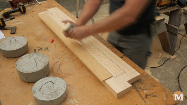Inset is glued to base and held in place with weights