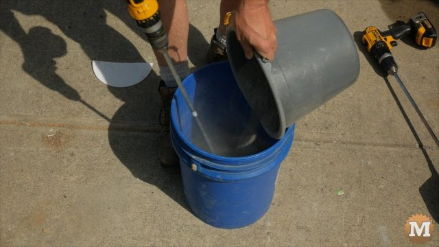 Slowly adding portland cement and glass fiber to water in the pail