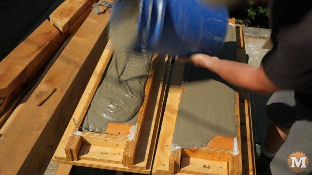 Pouring aircrete into garden box forms