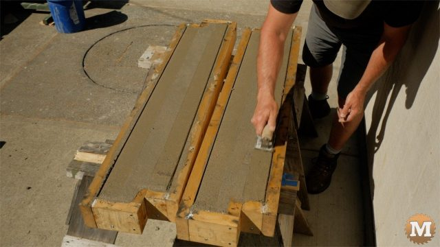 """Troweling and edging 48"""" vermiculite concrete panels after pouring"""