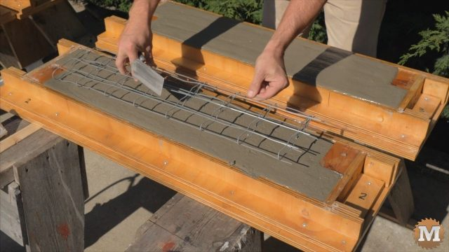 laying a reinforcing wire mesh before the aircrete hardens