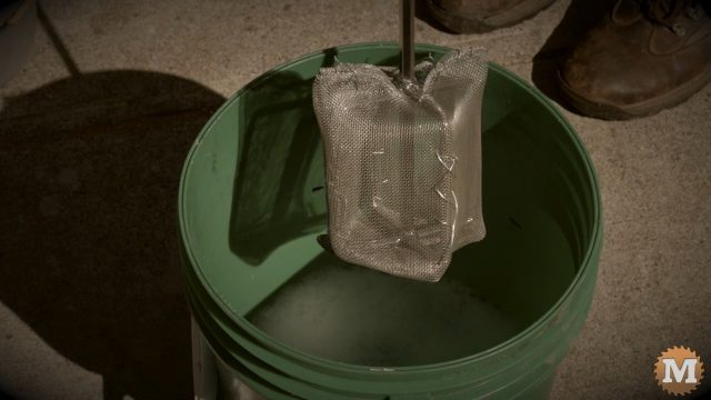 making foam in a pail with a paint mixer attachment on a drill