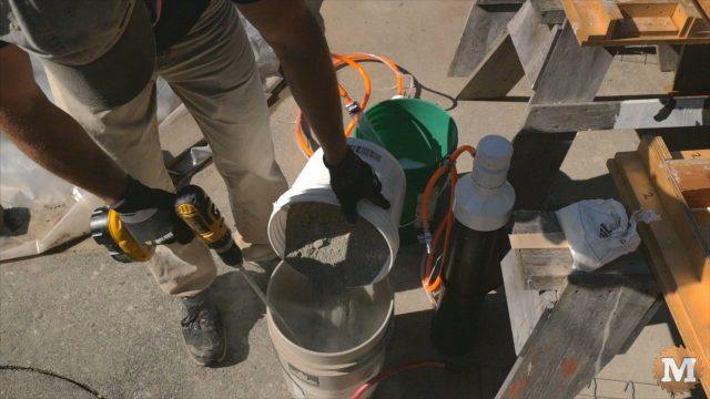 adding dry portland cement to the water