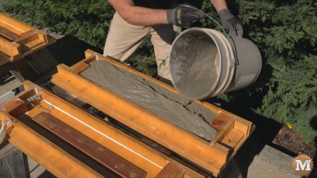 pouring the wet concrete aircrete mix into the form