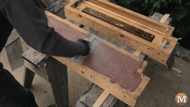 trowel smooth the wet concrete in the moulds