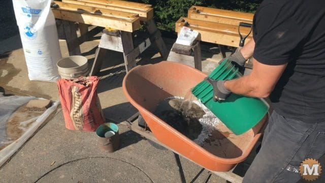 adding water to the dry concrete ingredients