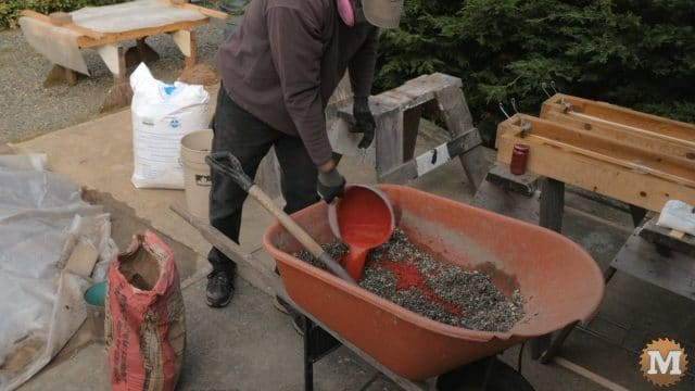 cement color added to perlite concrete mix an a wheelbarrow