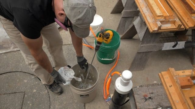 adding fiber to the wet cement mix
