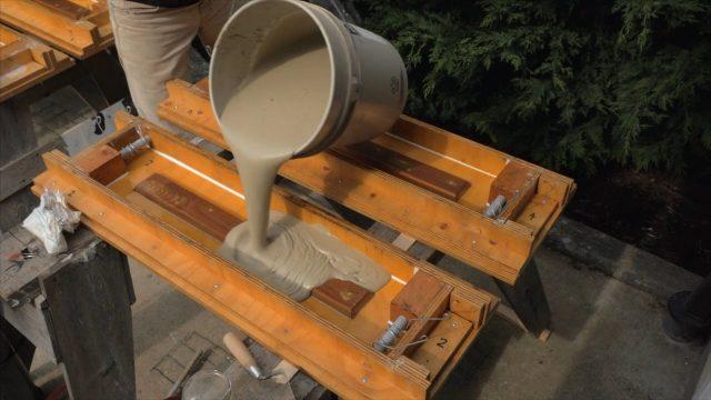 pouring CSA aircrete into a mold