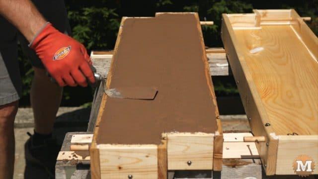 DIY Concrete Garden Box Easy Form - Small trowel smooth surface of concrete