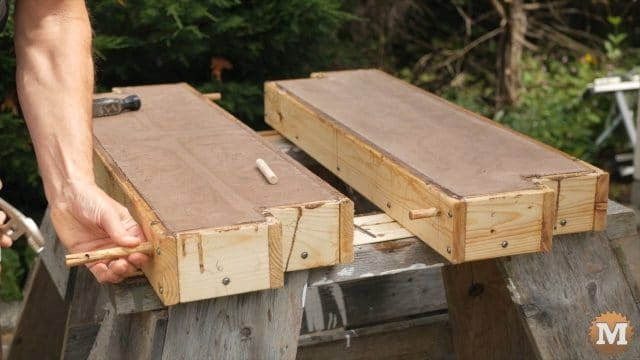 Concrete Garden Box Easy Form - removing wooden pegs