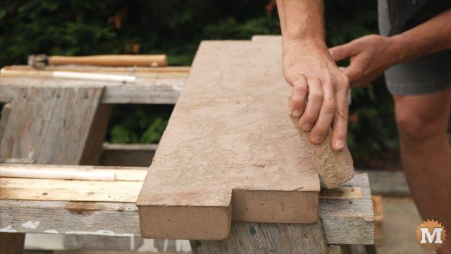 Remove sharp edge of casting with brick