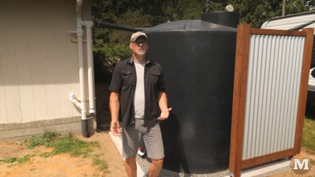 This 1200 gallon rainwater collection tank sits off the corner of my storage shed