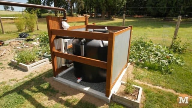 This off-grid 500 gallon tank is situated in the garden and feeds a small irrigation system that is powered by a 12V pump.