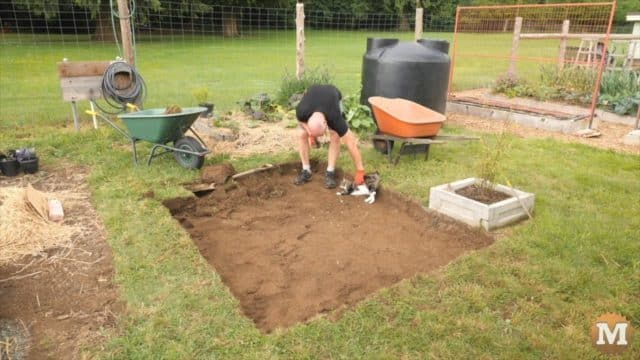 excavating a level place for the rain tank