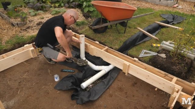 OFF GRID Rainwater Harvesting System - setting drain pipes in place under the tank gravel