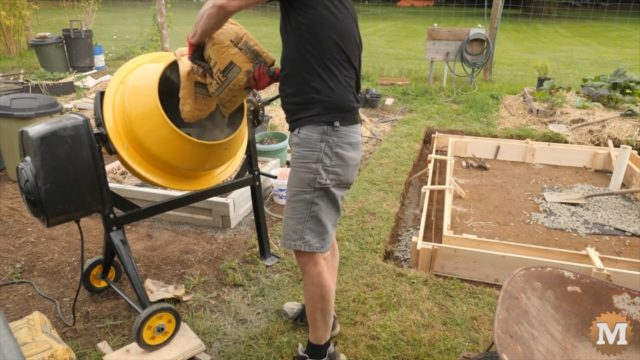 OFF GRID Rainwater Harvesting System - pouring concrete with a mixer into the forms