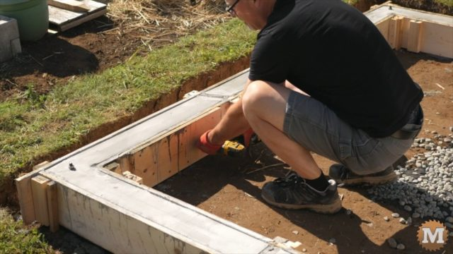 OFF GRID Rainwater Harvesting System - stripping the concrete form from the poured base curb walls