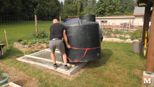 Setting 500 gallon rainwater tank in place