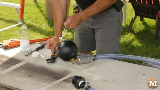 adding rope lanyard to float valve