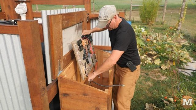 installing the solar board in the off grid pump house