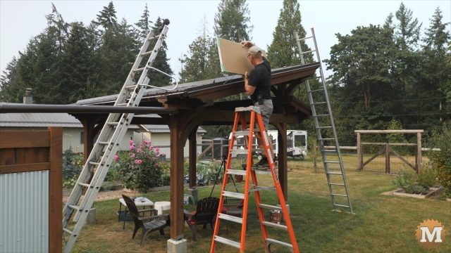 setting the solar panel on the pavilion roof