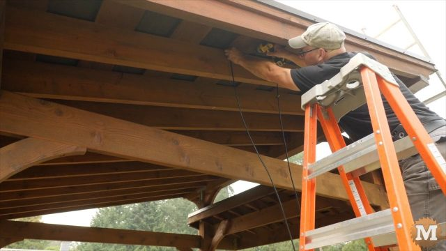 securing solar panel wires to roof rafters under pavilion