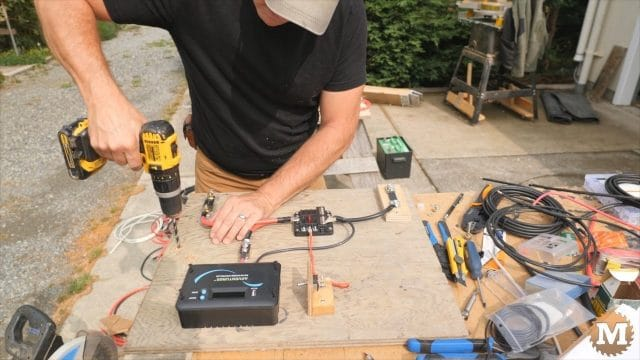 drill holes in plywood control board to add bolt terminals for sola panels