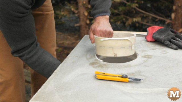 Cast your own Concrete Countertop for a Potting Bench with a Galvanized Corrugated Metal Roof